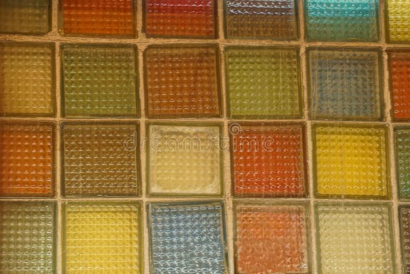 Colored texture of squares of glass on the wall stock photos