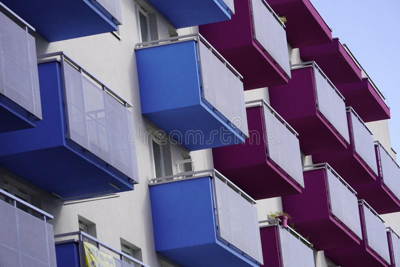 Colored balconies of a house, make life brighter, decorate everyday life. bright colors of apartment building. Colored balconies of house, make life brighter stock photo