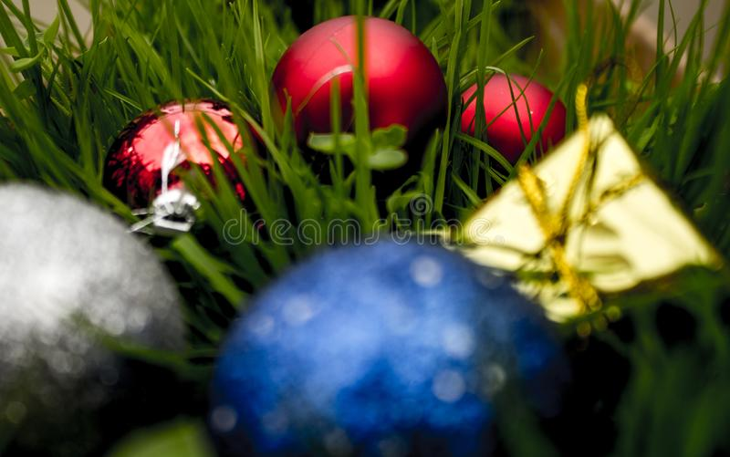 Colored Balls for Christmas with leafs royalty free stock images