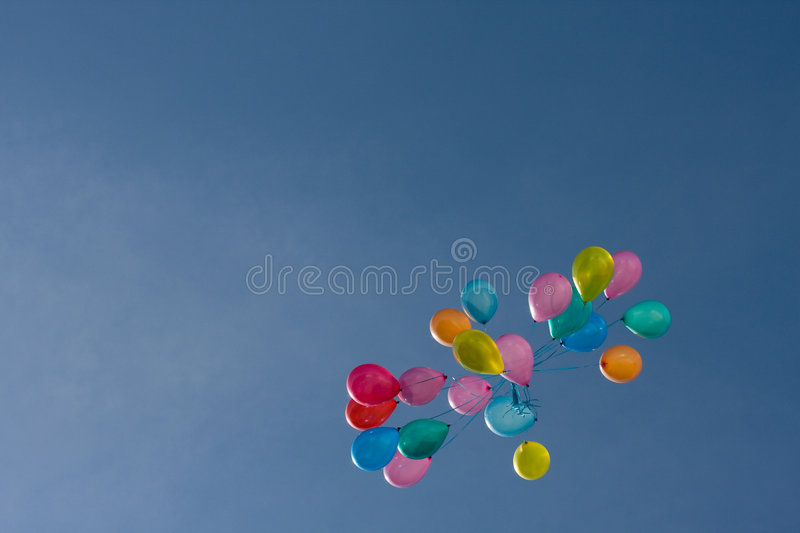 Colored baloons in the sky stock photography