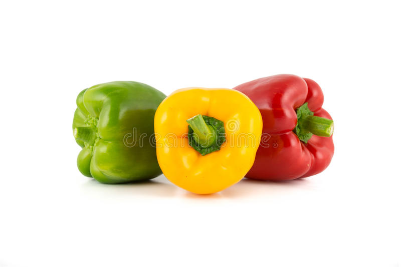 Colored bell peppers. Colour bell peppers isolated on over white background royalty free stock photos