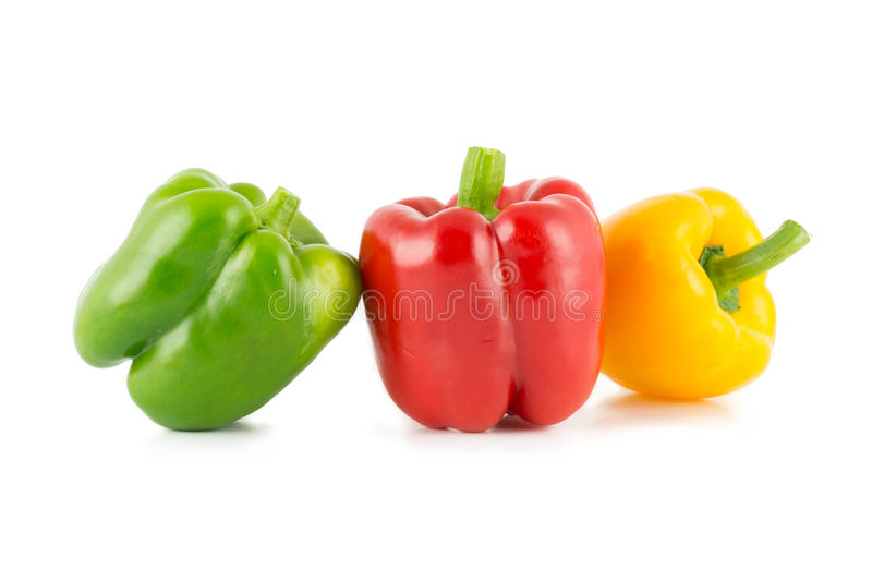 Colored bell peppers. Colour bell peppers isolated on over white background royalty free stock images