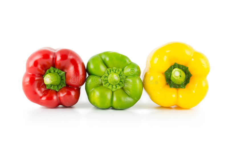 Colored bell peppers. Colour bell peppers isolated on white background royalty free stock images