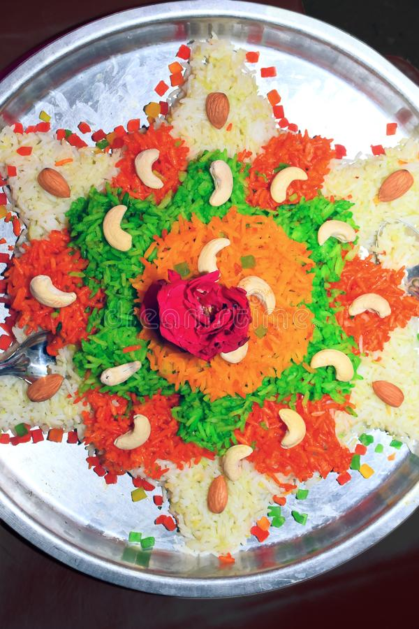 Colored birang rice decorated with flowers and dry fruit_ royalty free stock photo