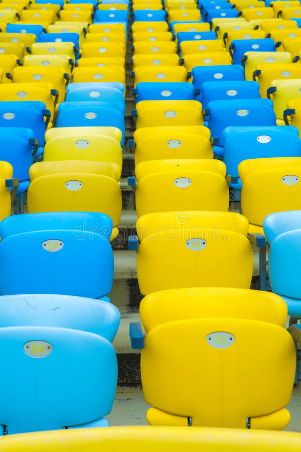 Colored blue and yellow seats royalty free stock photo