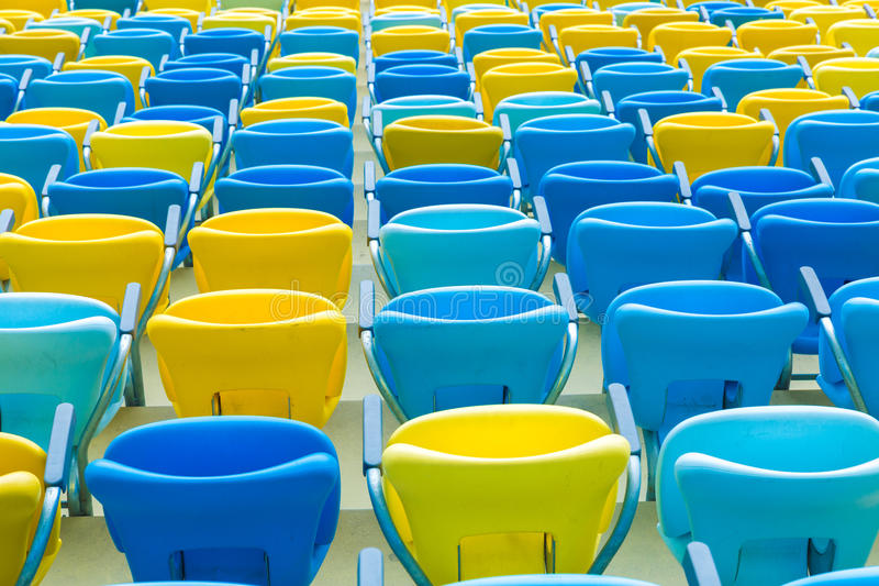 Colored blue and yellow seats royalty free stock images