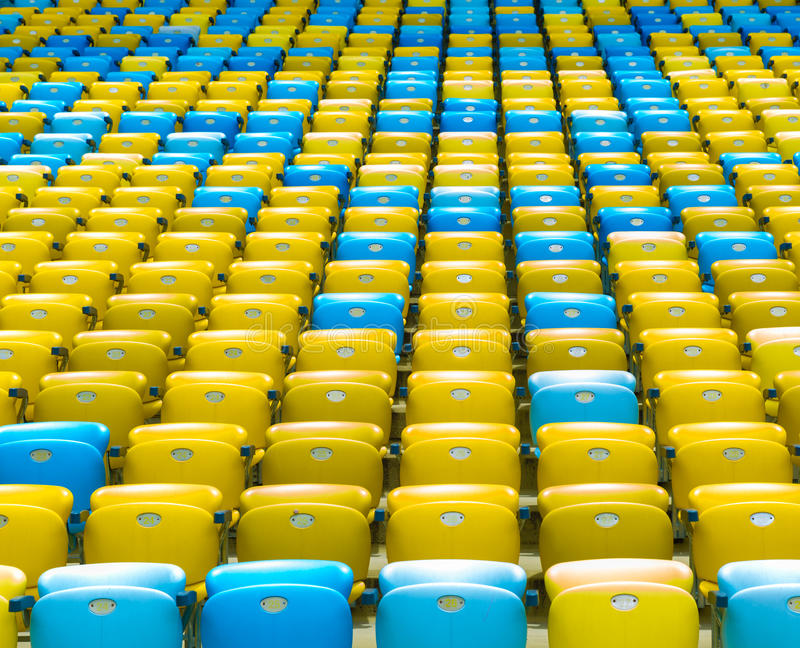 Colored blue and yellow seats royalty free stock photos