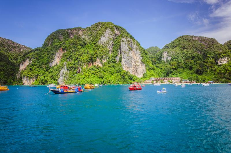 Colored boats in the ocean bay near Phi Phi islands stock photography