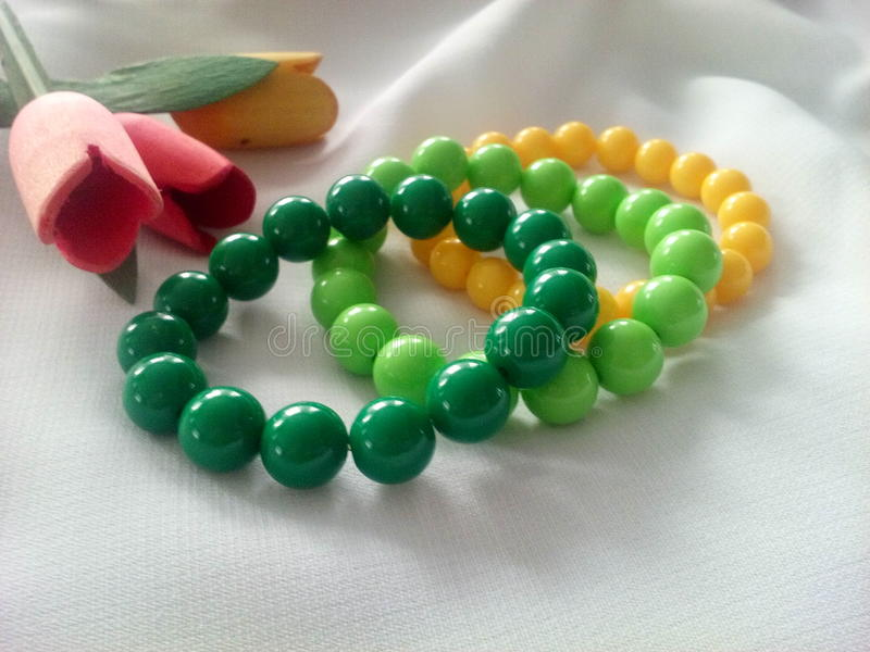 Colored bracelets with beads royalty free stock images