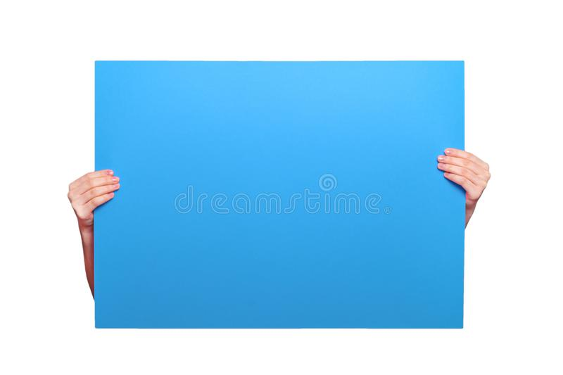 Colored bright poster in hands close-up. Layout blank for an ins. Cription or text. Blue sheet of paper stock images