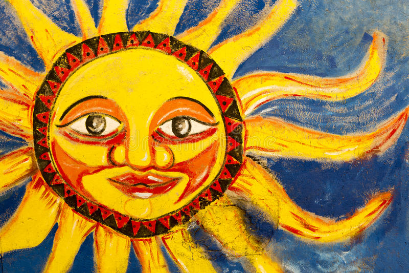 Colored bright sun mural painted on wall in Santa Marta, Colombia stock photos