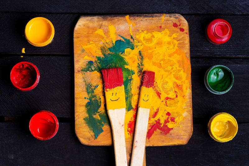 Colored brushes smile fun and happy. stock image