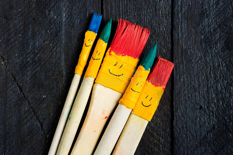 Colored brushes smile fun and happy. royalty free illustration