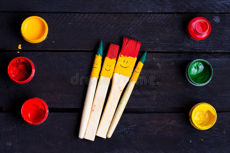 Colored brushes smile fun and happy. stock illustration