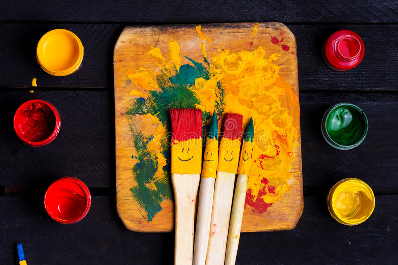 Colored brushes smile fun and happy. royalty free stock images