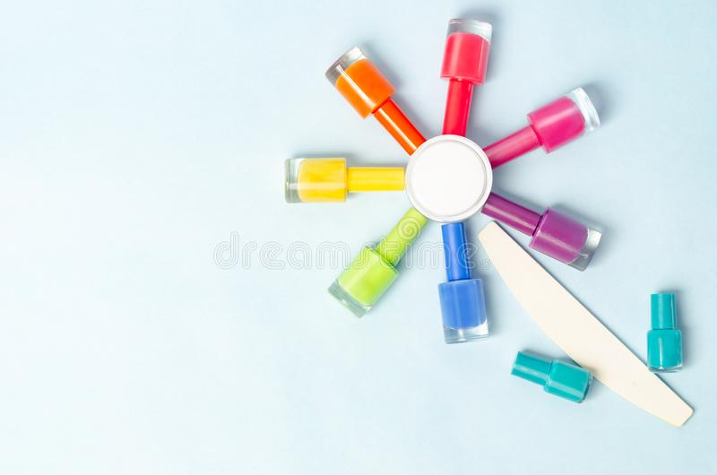 Colored bubbles with varnish on an isolated surface with a nail file in the shape of a flower royalty free stock images