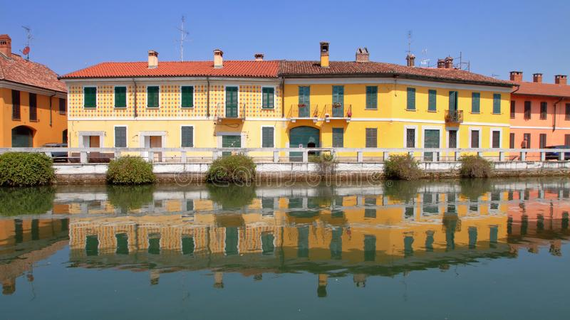 Colored buildings with reflections in the water in italy. The pic shows colored buildings with reflections in the water in italy royalty free stock photo