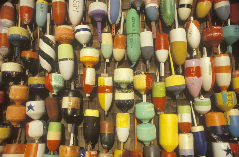 Colored buoys hanging from wall stock images