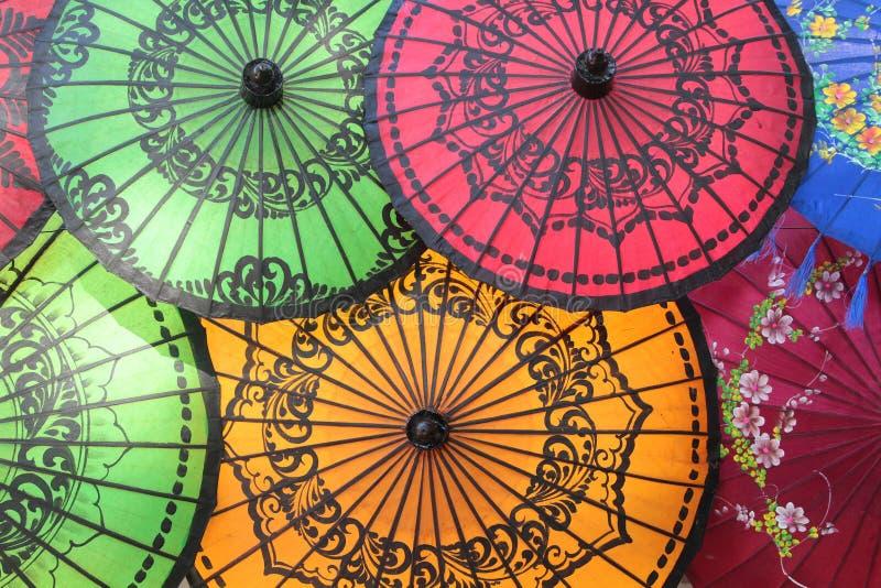 Colored Burmese Umbrellas. Colored Red, Green and Yellow Burmese Umbrellas stock photos