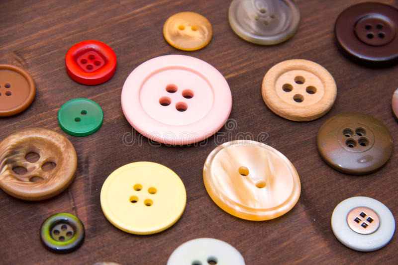 Colored buttons closely on wood stock photo