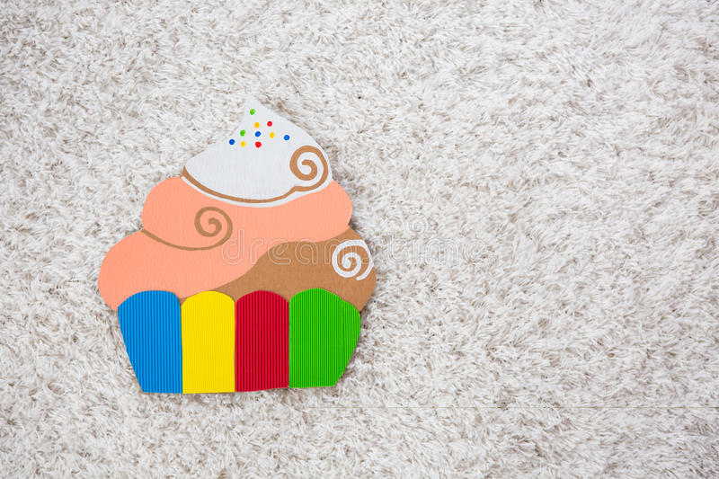 Colored cake handmade of cardboar. On white background royalty free stock image