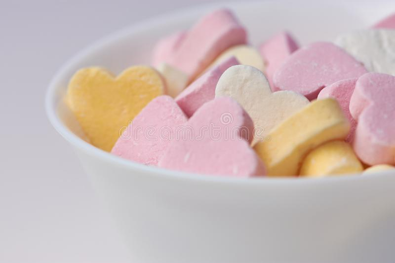 Colored candy hearts, close up stock photo