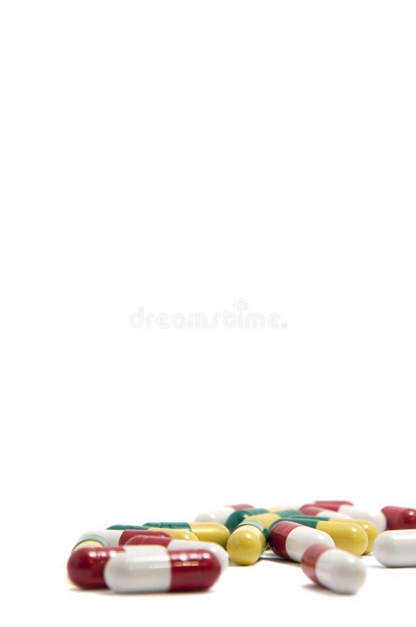 Colored capsules stock photos