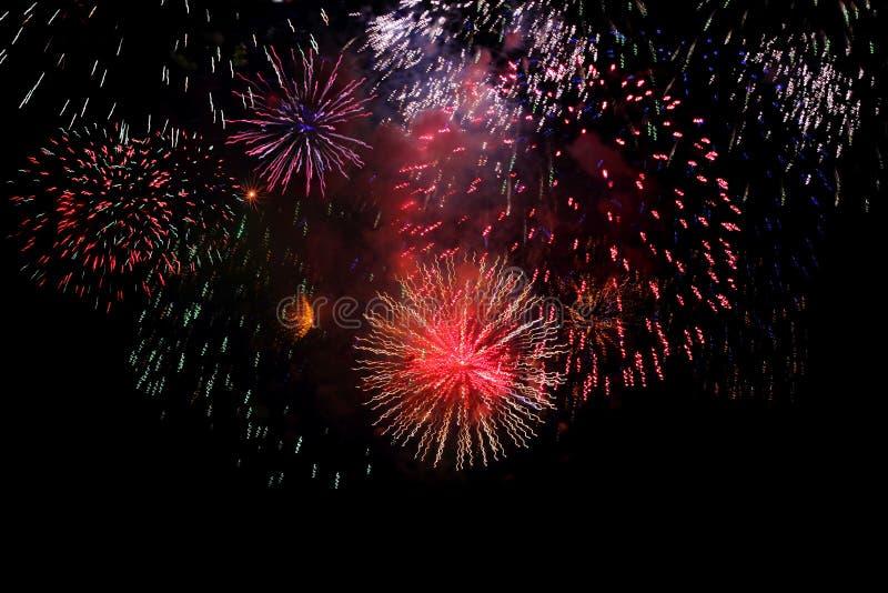 Multicolored Firework. Colored celebratory firework at night sky stock photos