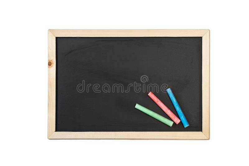 Colored chalks and a chalkboard stock image