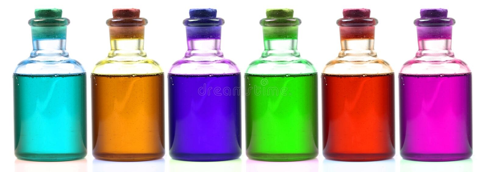 Colored chemical bottles. Isolated on white background royalty free stock photography