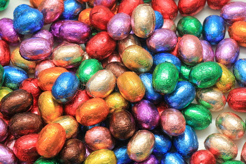 Colored Chocolate easter eggs. Big pile of colorful wrapped chocolate easter eggs royalty free stock photo
