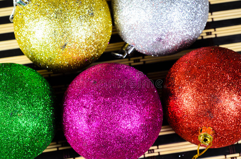 Colored christmas balls. On a bamboo mat royalty free stock images