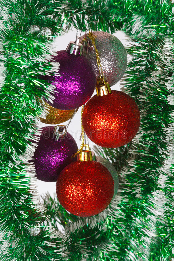 Download Colored Christmas Balls On A Green Tinsel Stock Photo - Image: 36327192