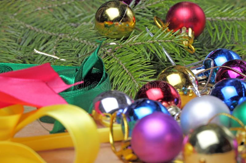 Colored Christmas balls and colored ribbons stock photos