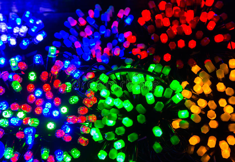 Colored Christmas lights. Brightly colored Christmas lights, holiday, background stock image