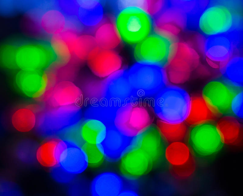 Colored Christmas lights. Brightly colored Christmas lights, holiday, background, Rasfokus stock image