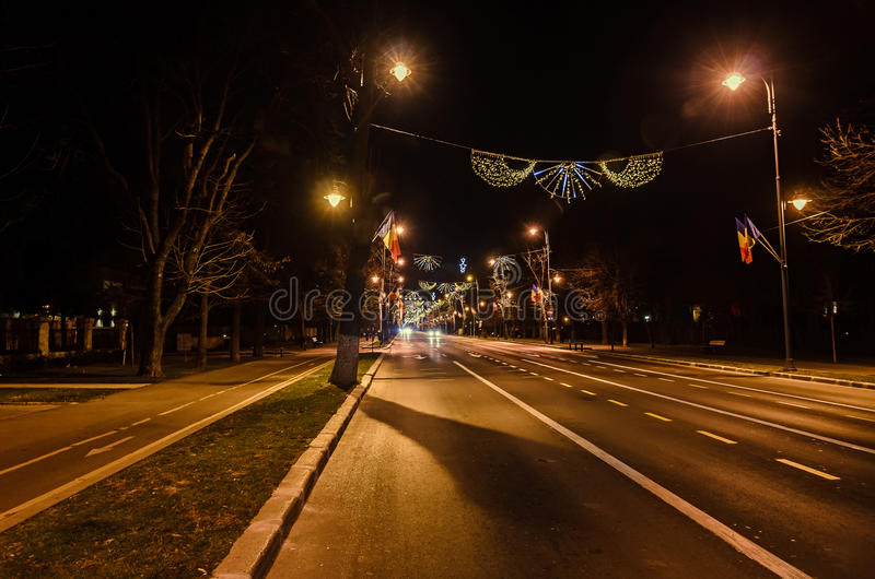 Colored Christmas lights and ornaments. In downtown of Bucharest, Romania night time stock photos