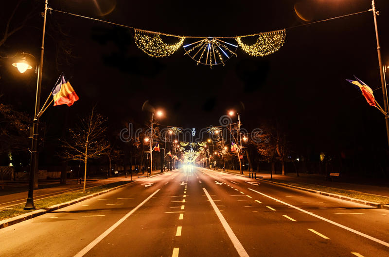 Colored Christmas lights and ornaments. In downtown of Bucharest, Romania night time stock photo