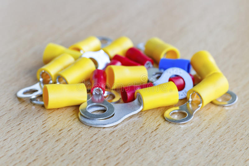 Colored circular pre-insulated cord ends on the table closeup royalty free stock image