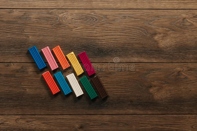 Colored clay lies on a wooden brown table. Copy space.  stock image