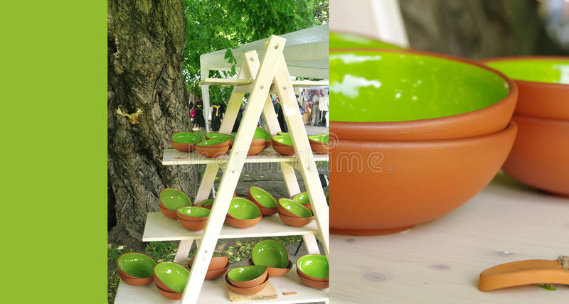 Colored clay plate on a stand at the fair of artisans in Riga stock images