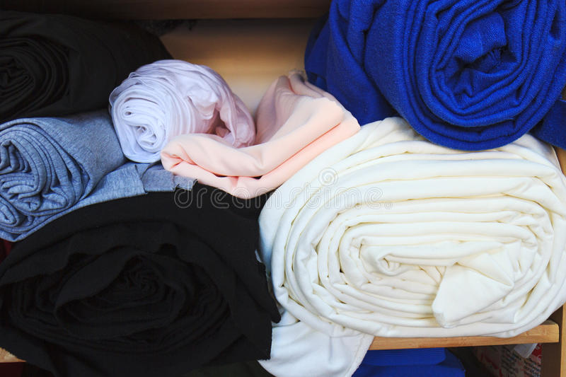 Colored cloth for making dresses. Making stock photography