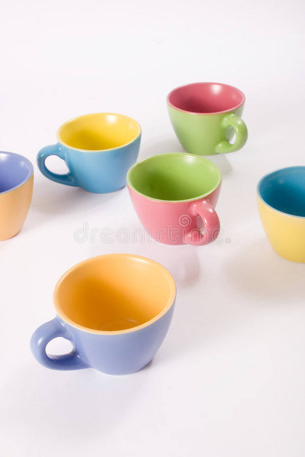 Colored coffee cups stock photography