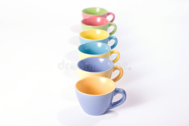 Colored coffee cups in a row stock photo