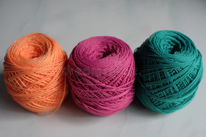 Colored cotton yarn handicraft materials. Colored cotton yarn reels that are used as knitted handicraft materials royalty free stock photo