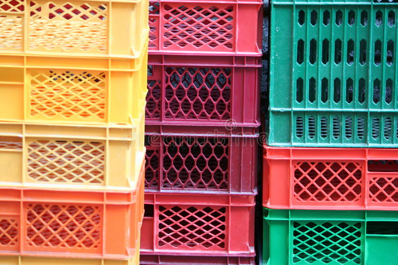 Colored crates. Coloured stacks of fruits and vegetable crates in a storehouse royalty free stock images