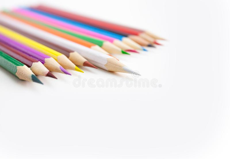 Selective focus on the tips of colored pencils on white background royalty free stock photography