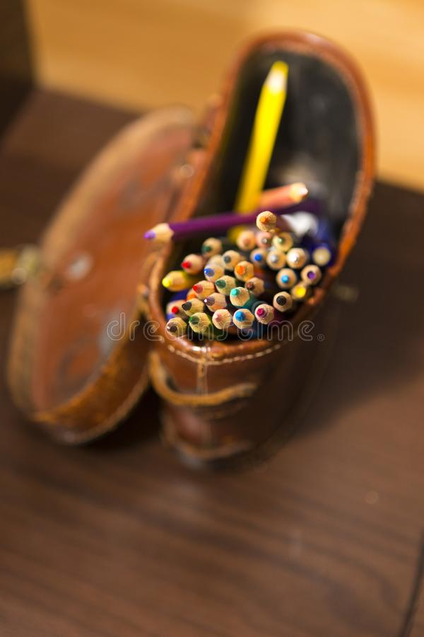 Colored crayons in a leather bag stock images