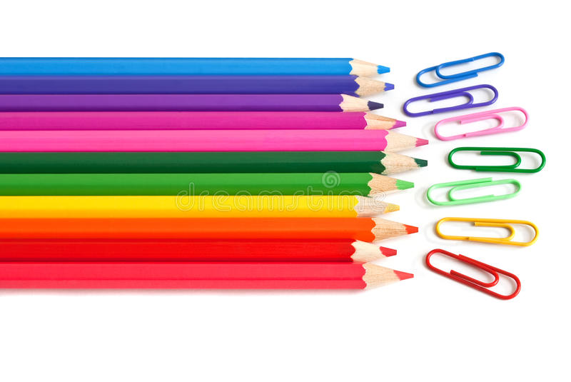 Colored crayons and paper clips, office stationery stock image