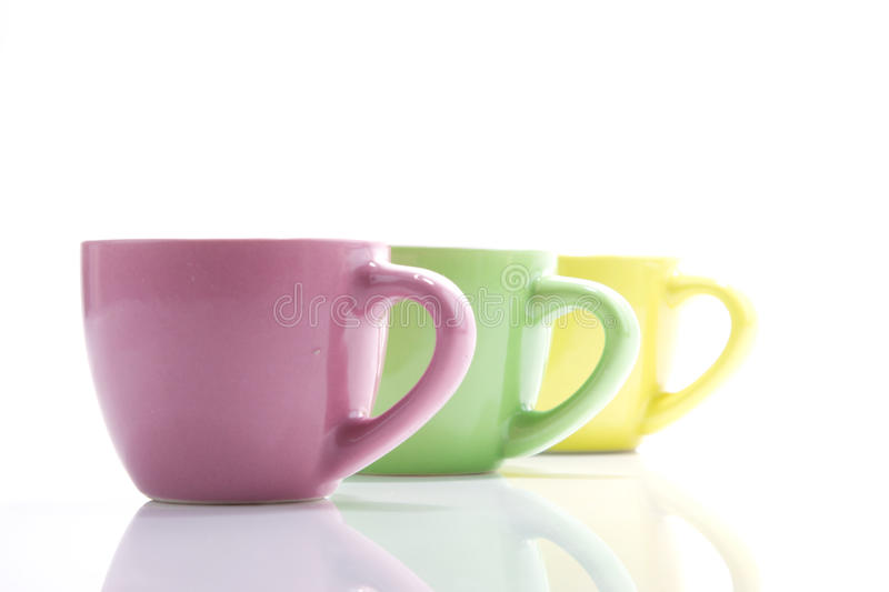 Colored cups in line royalty free stock photo